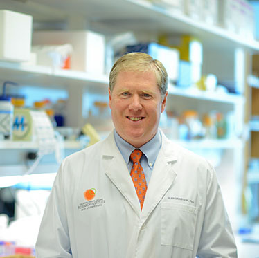 Dr. Sean Morrison standing in the lab.