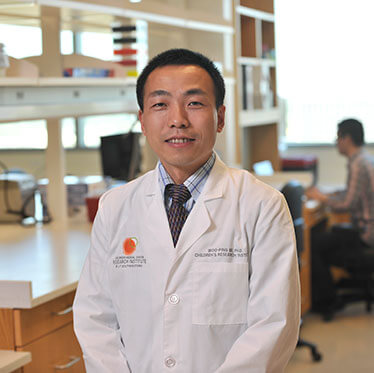 Dr. Woo-Ping Ge standing in the lab.