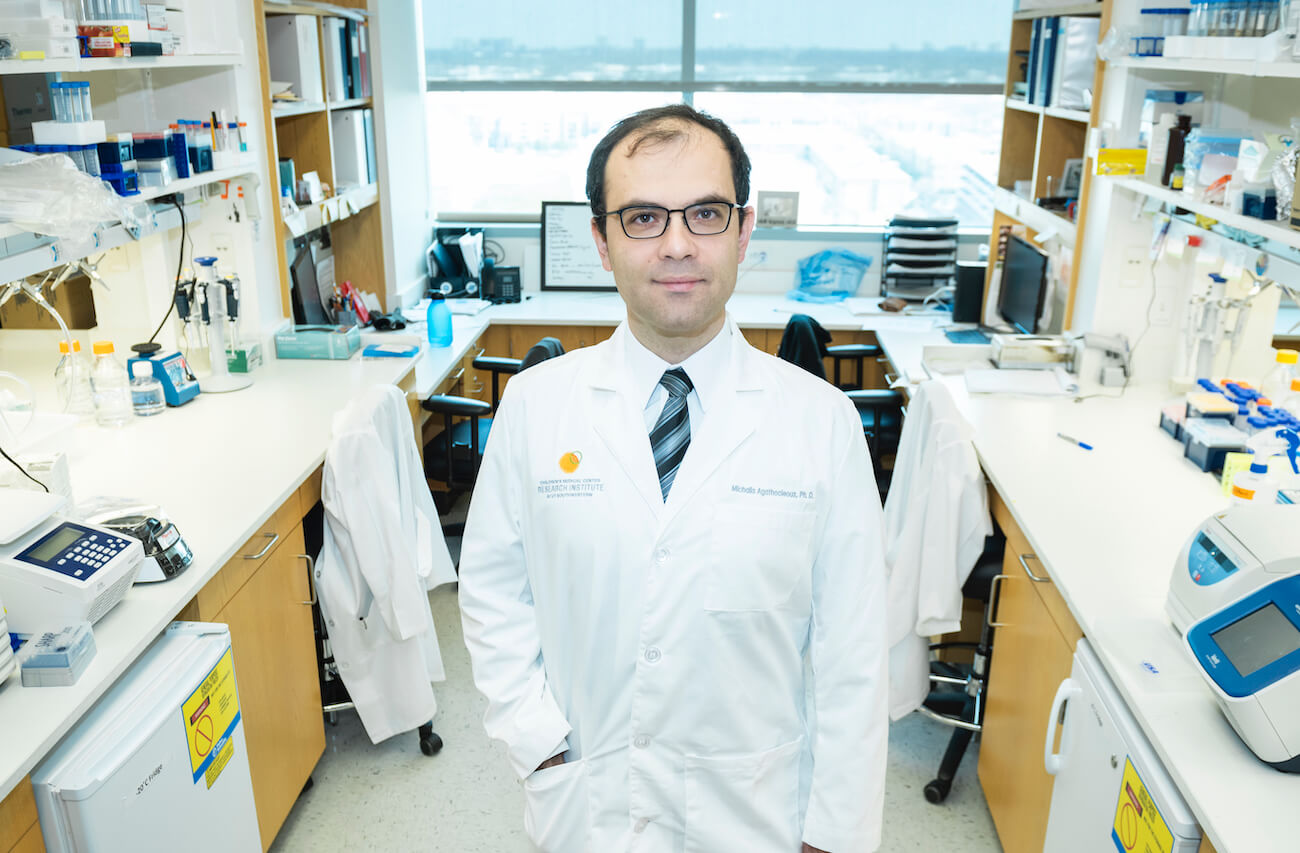 Michalis Agathocleous, stem cell researcher, stands in the lab.